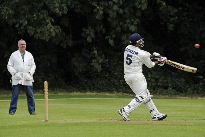Omer playing cricket at Open Uni